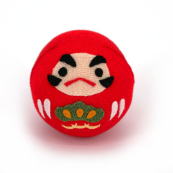 Muñeca okiagari daruma roja...